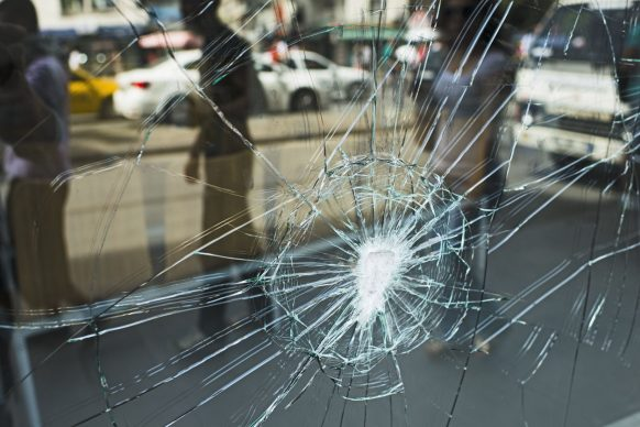 Why would a glass sliding door shatter spontaneously?